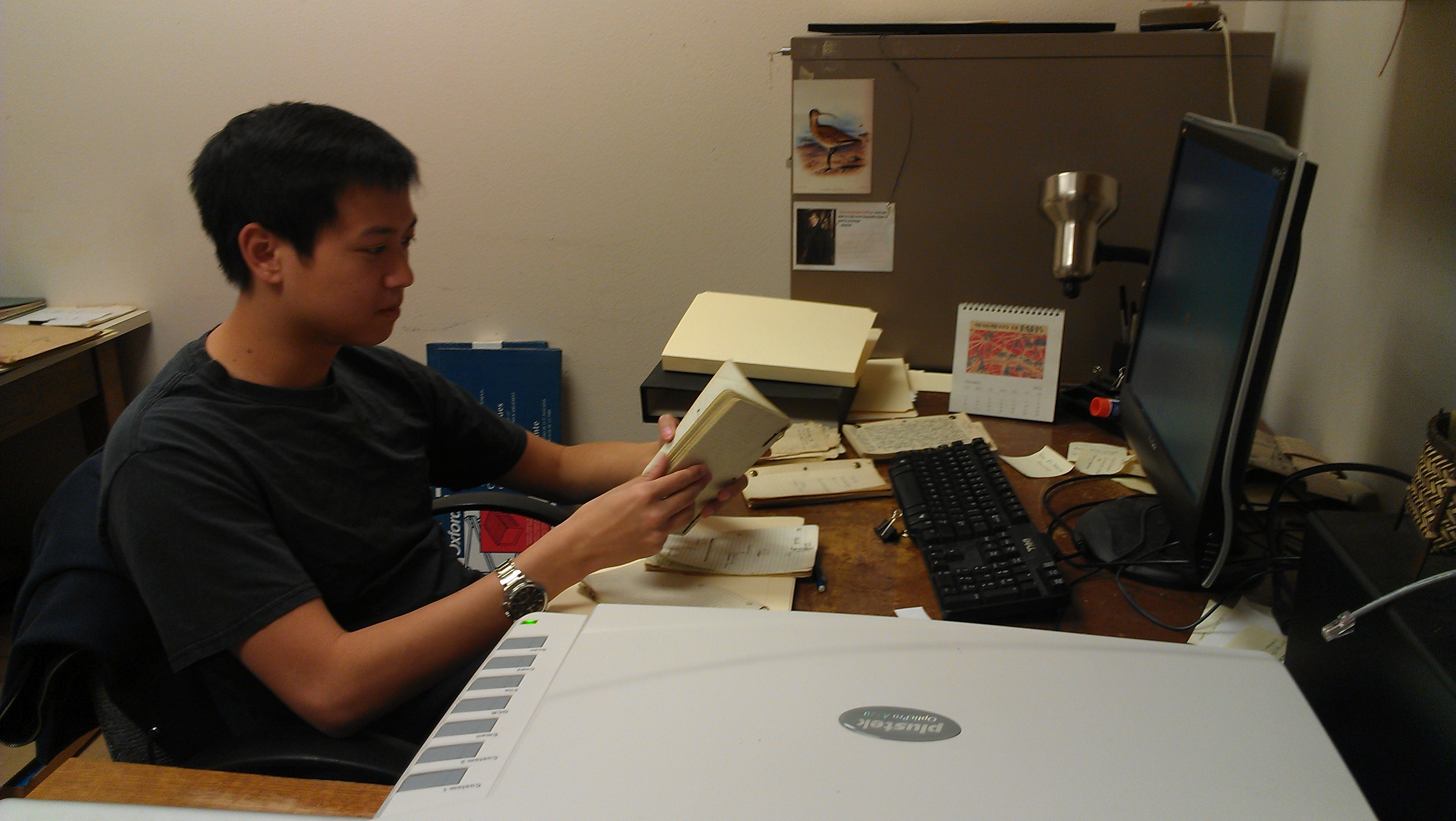Darren Lu working through Alden H. Miller's papers.